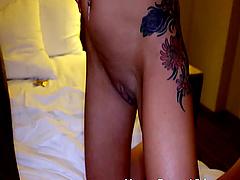 Blonde slut with large fake tits enjoys riding a large black dick