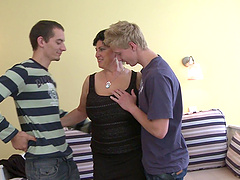 Busty mature amateur undressed and fucked by two younger guys
