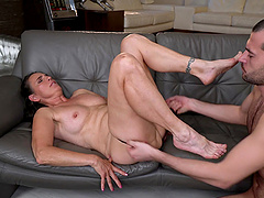 Old slut Mariana spreads her legs to be fucked by a younger guy