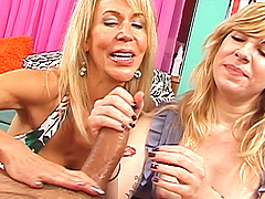 Two mature babes enjoy stroking his large dick in POV video