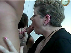 Muscular man gets his dick sucked by a mature and a younger chick
