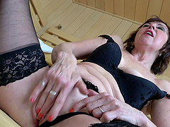 Foxy mature Dana in black lingerie drops on her knees to suck a dick