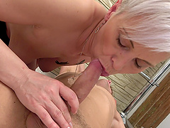 Mature blonde slut drops on her knees to have sex with a younger guy