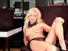 Home alone mature Sylvie takes off her panties to masturbate