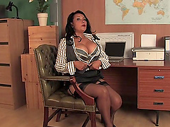 Busty mature Danica Collins drops her panties to ride a dildo