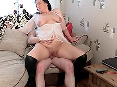 Slutty British mature Juicy Ju loves having sex with her neighbor