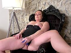 Chubby mature amateur sucks and rides her favorite purple dildo
